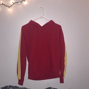 red hoodie w/ white & yellow stripes on the sleeve